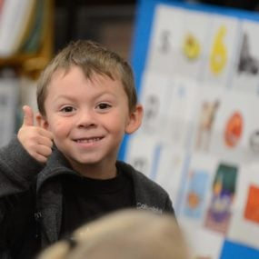 Close up of student giving a thumbs up