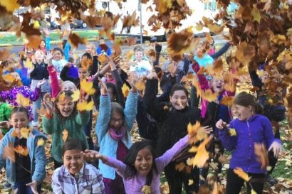 Lincoln students throwing leaves