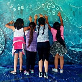 Elementary kids working on a mural